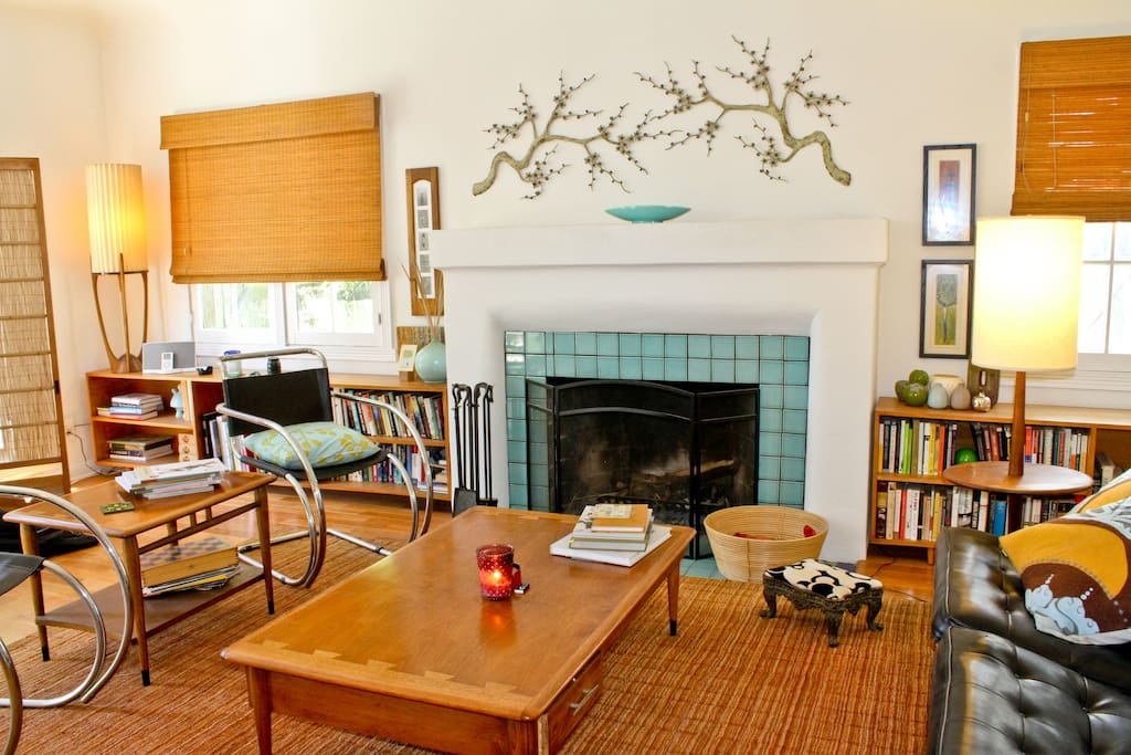 Big living room with endless windows and mid-century furnishings. The fire is always going when it's  chilly.