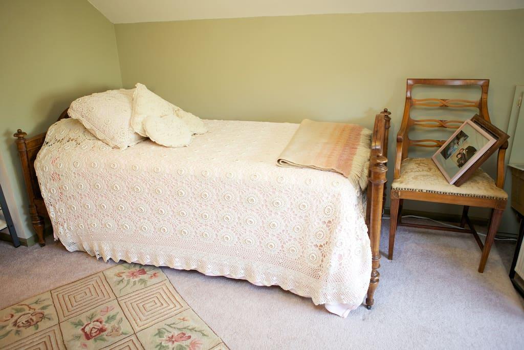 Elegant antiques decorate the guest suite.