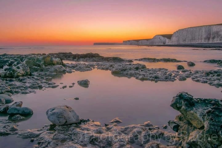 Seven Sisters Cliffs from the beach at sunset