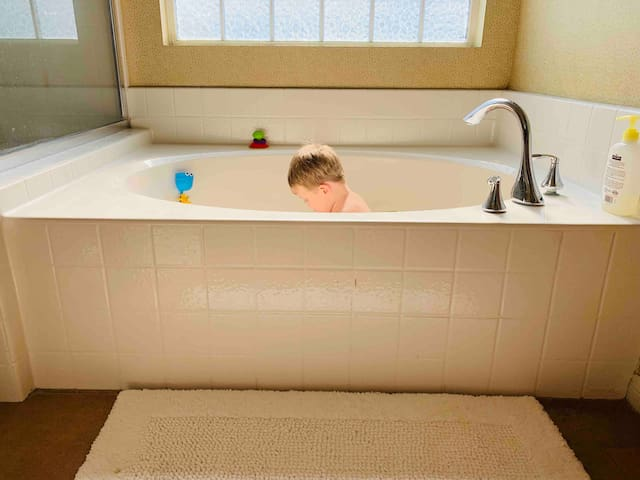 Large soaking tub in master bathroom. Great for children!