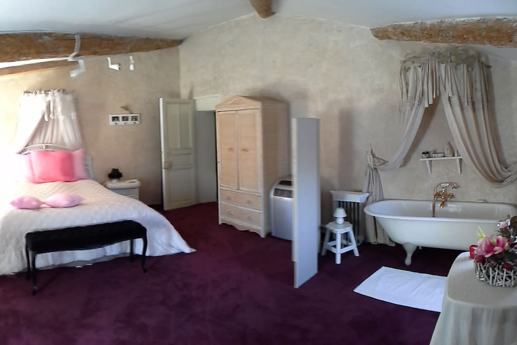 Double bedroom with bath and wash basin