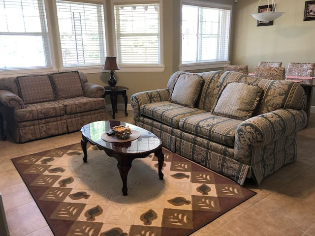 Comfy pullout queen bed sofa originally  bought from Sears in living area.
