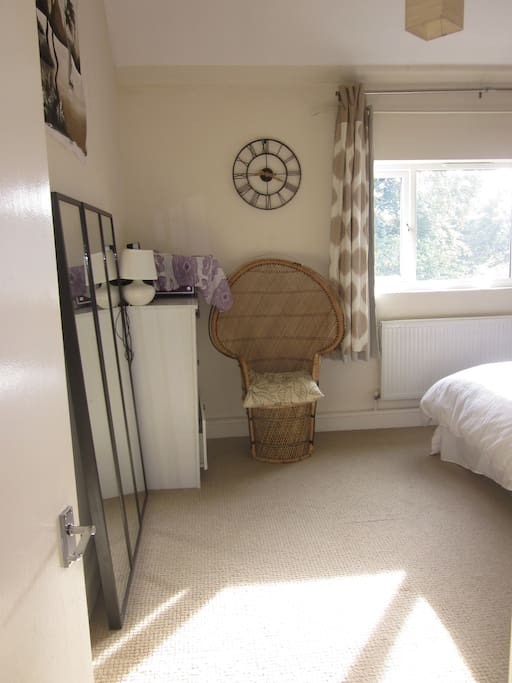 Very large, open and bright master bedroom with three extra wide full length mirrors - could fit an extra person sleeping on extra sofa cushions/sleeping bag available