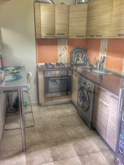 Kitchen-washingmachine, fridge,oven for cooking.