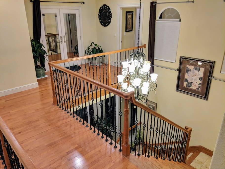 Coming around and up the staircase you will reach a hardwood floor balcony leading over to your private upstairs guest room.