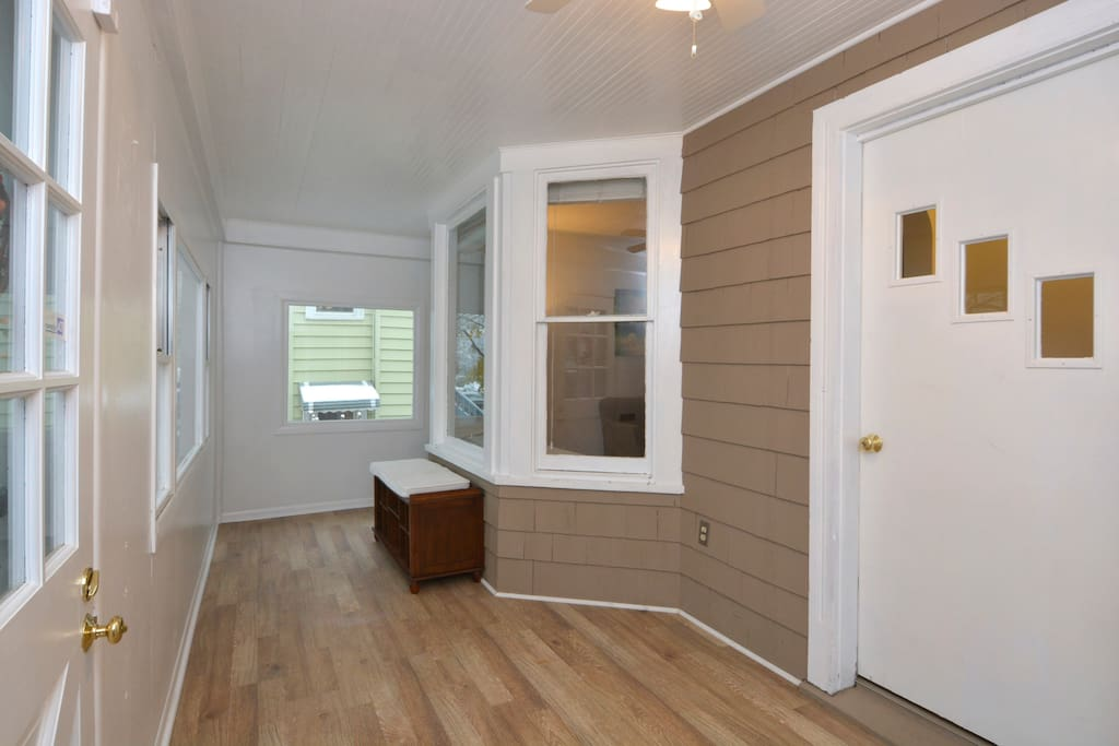 Our enclosed front porch is an ideal spot to watch the neighborhood walk by
