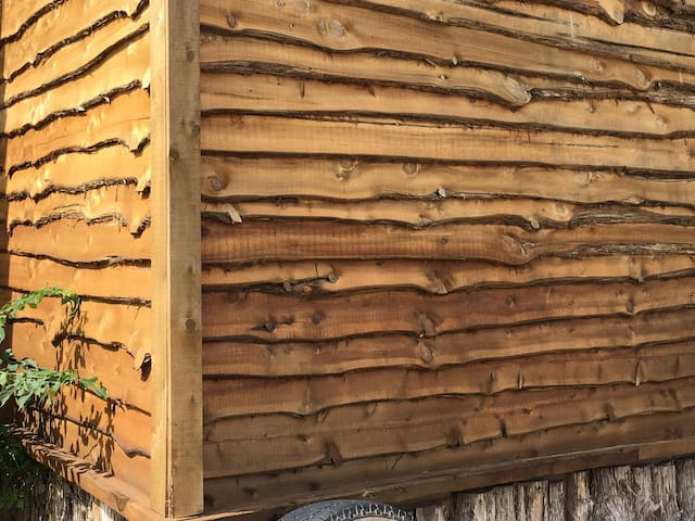 The live edge siding i milled from spruce trees.