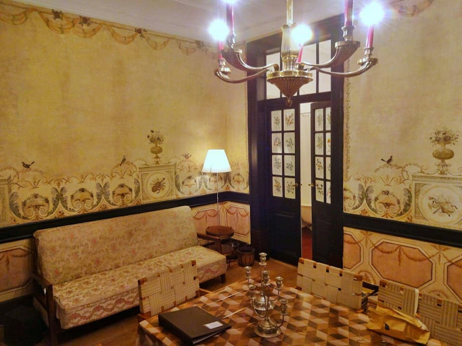 18th century mural paintings and Belgian 1930s De Coen furniture in our living room