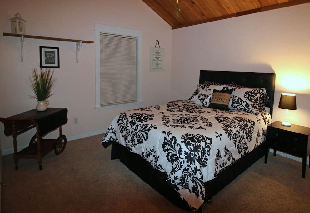 Queen bed across from second full bath.