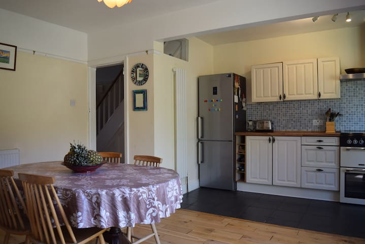 Dining rooms leading into the kitchen. We have a large combined fridge and freezer.