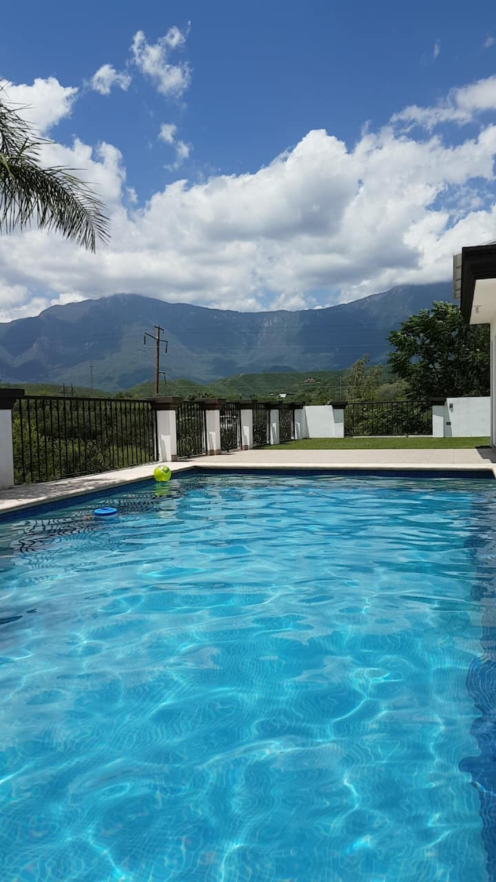 House equipped with pool, palapa and large garden.