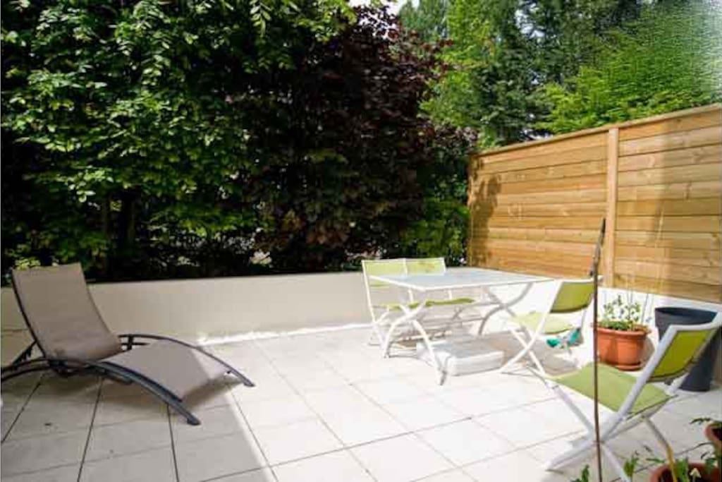 Enjoy a meal on your private terrace in this quiet garden