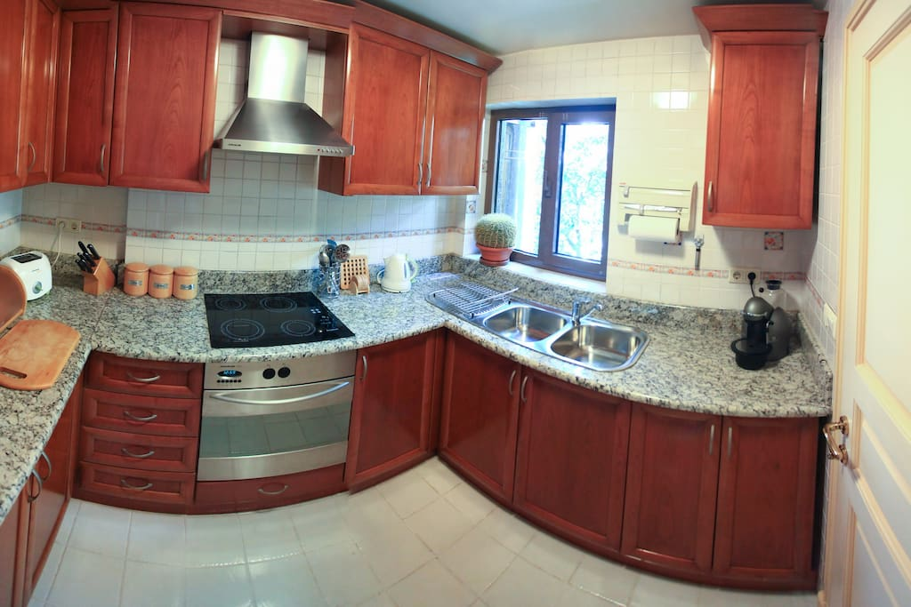 A complete set of modern kitchen appliances,         microwave, large refridgerator and full set of dining service. 24hour hot water.