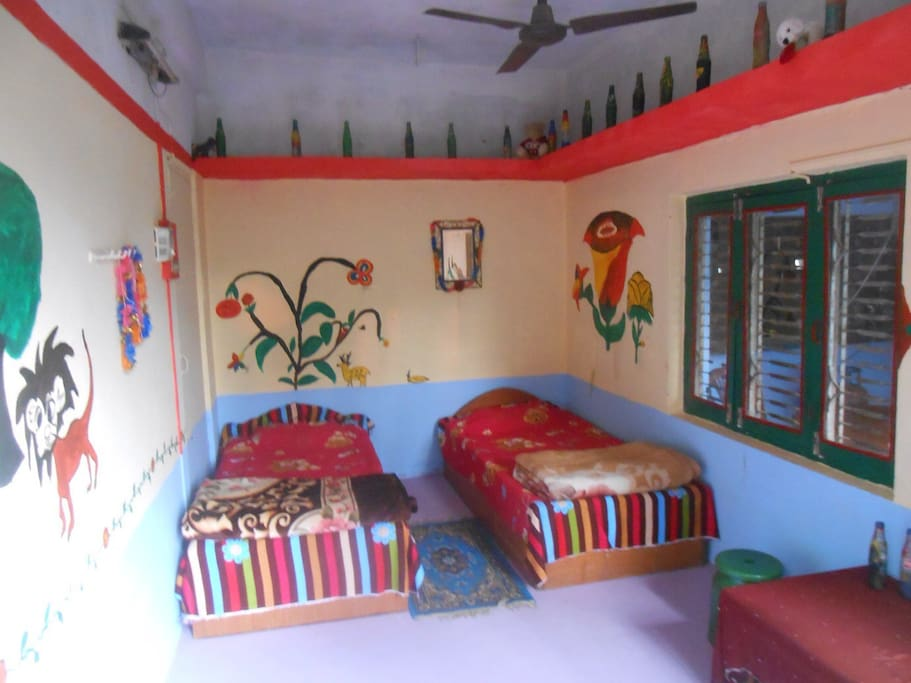 The bedroom with art work by the children