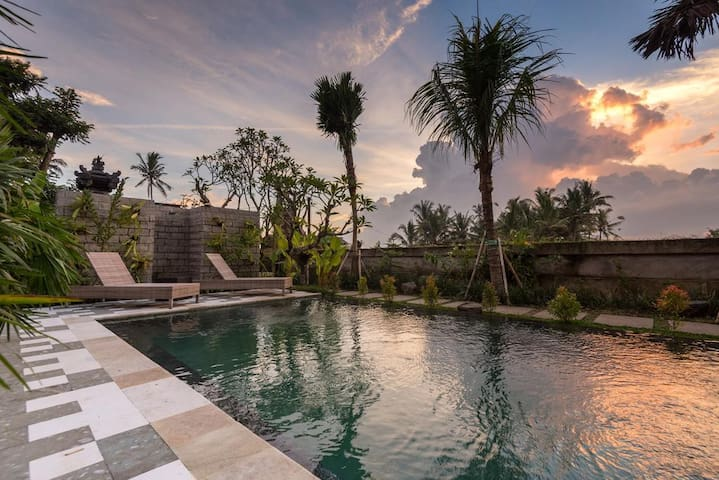 Watch the sun sets while dipping by the swimming pool