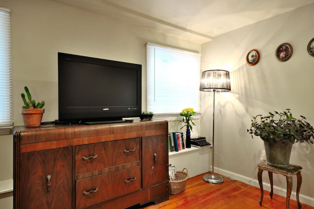 Flat-screen TV with cable.