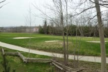View from rear deck overlooking golf course with view of escarpment