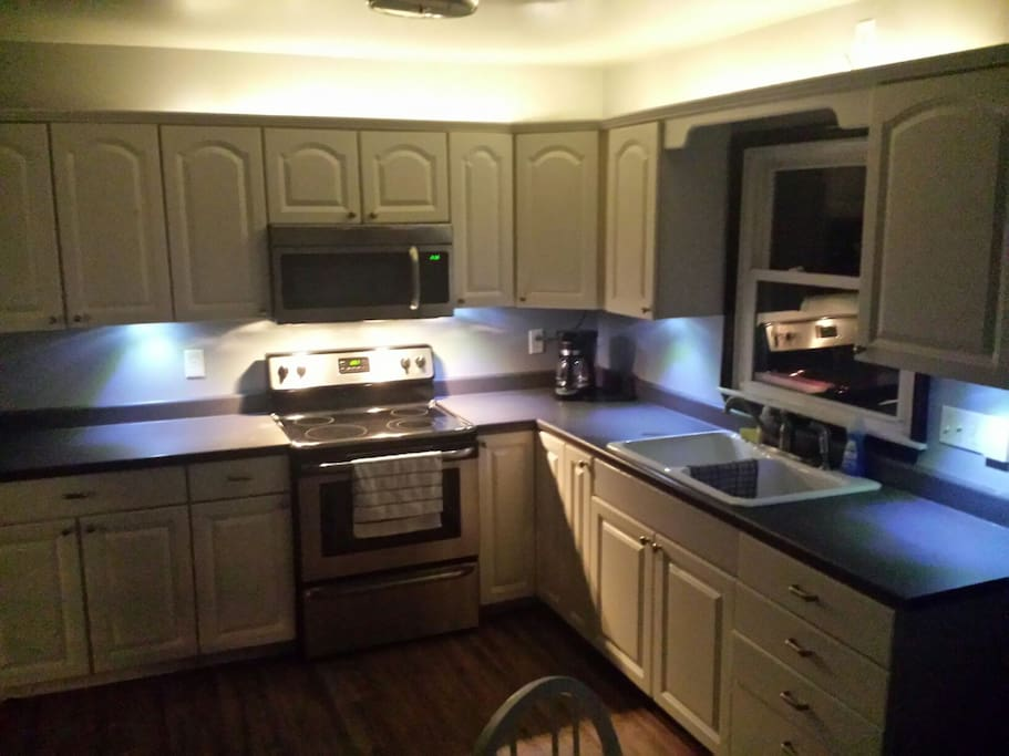 Cool lighting in new kitchen!  Cook away!