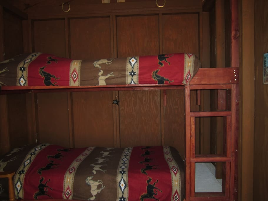 Inside is single bunk bed with real mattress, pillow and clean bedding.