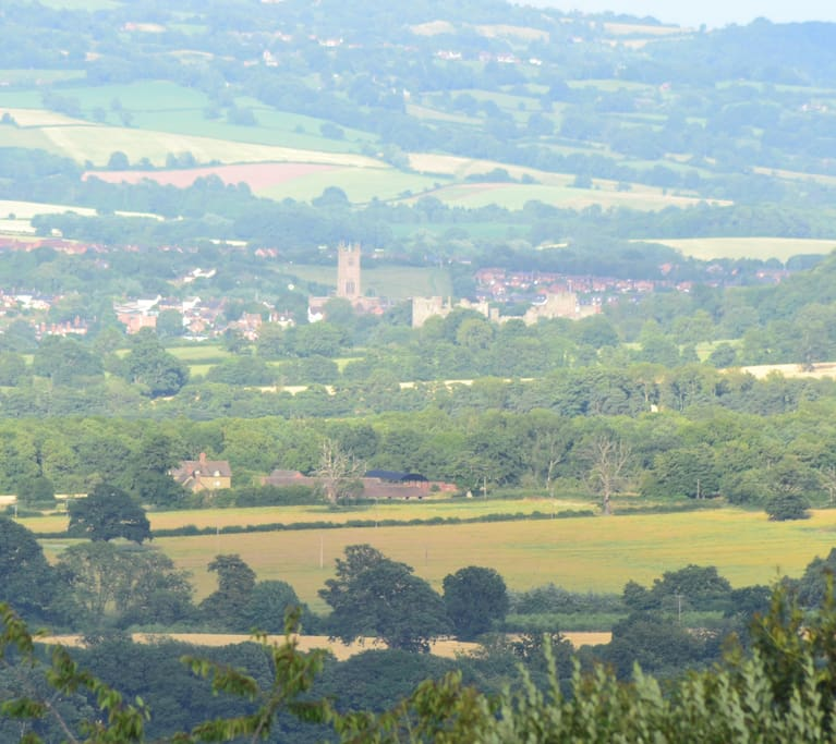 The Poles nestling in the valley with Ludlow beyond.