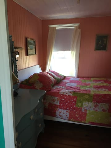 Bedroom on the first floor with queen bed