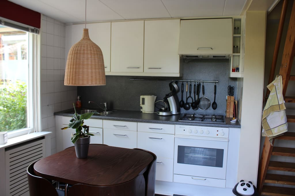 Kitchen with equipment and dining table