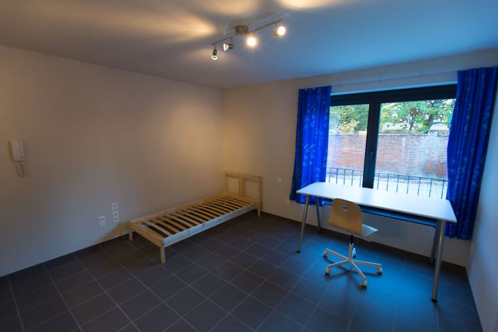 Modern, basic room with lots light in Geel center