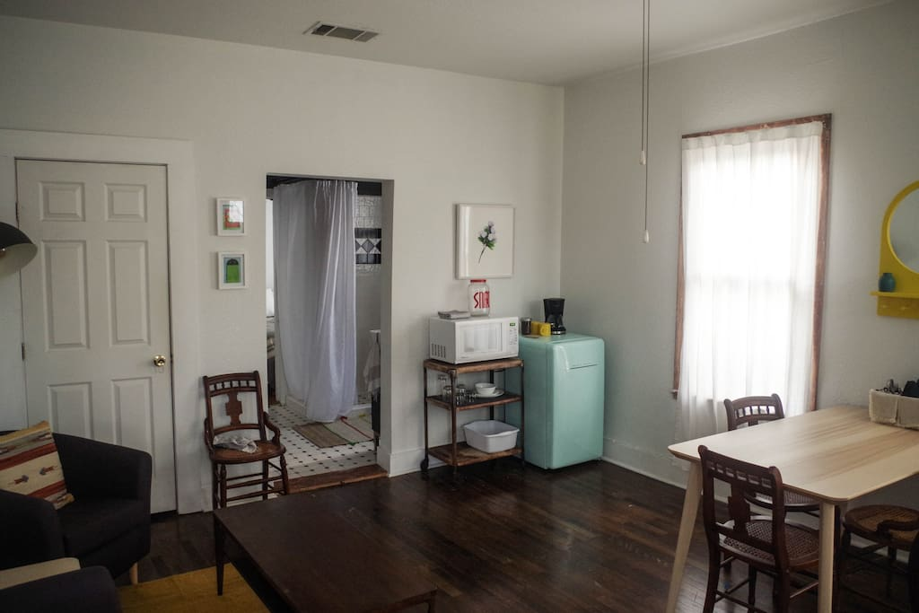 Kitchenette with fridge, coffee maker, and microwave.