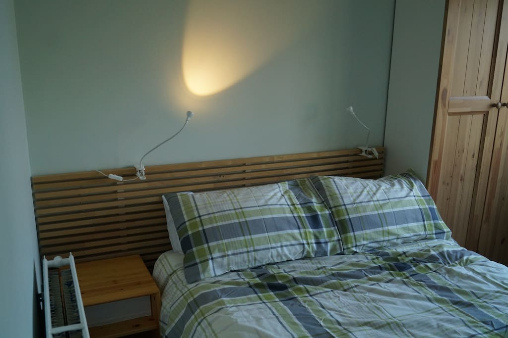 A comfortable double bed in a spacious room.