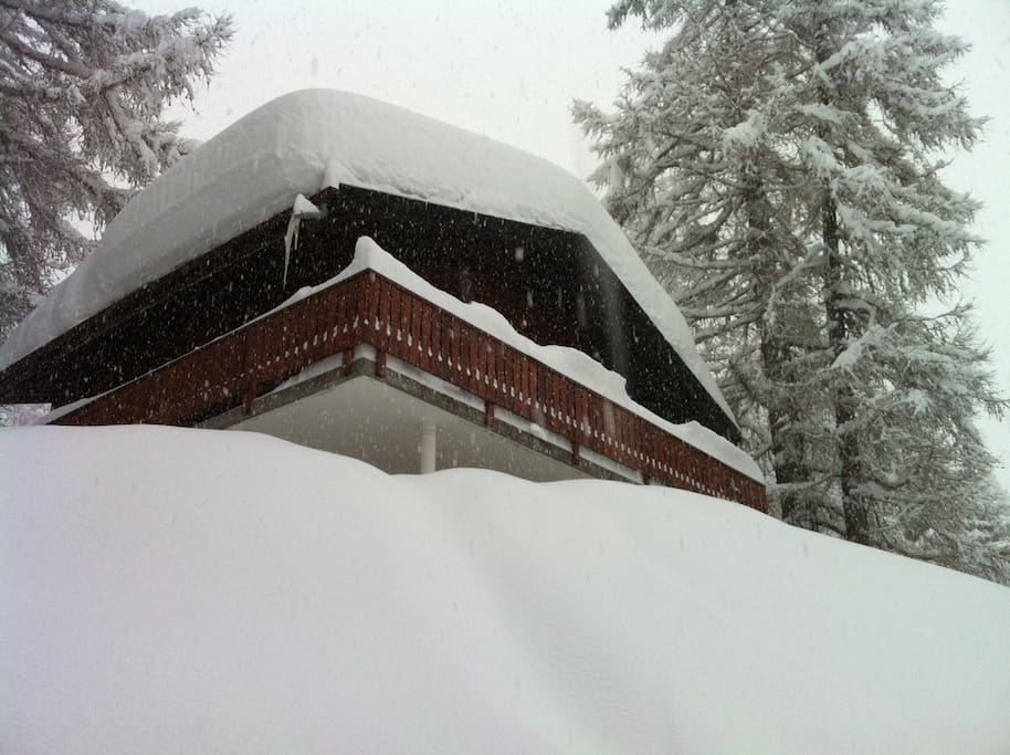 The house in romantic deep snow