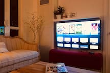 TV in living room with Apple TV. Netflix with high speed access