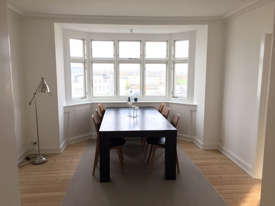 Sunlit dinning room with view of central Copenhagen