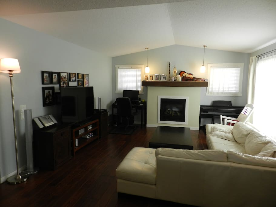 Big screen smart TV with Netflix, stereo, fireplace, piano, large sectional...