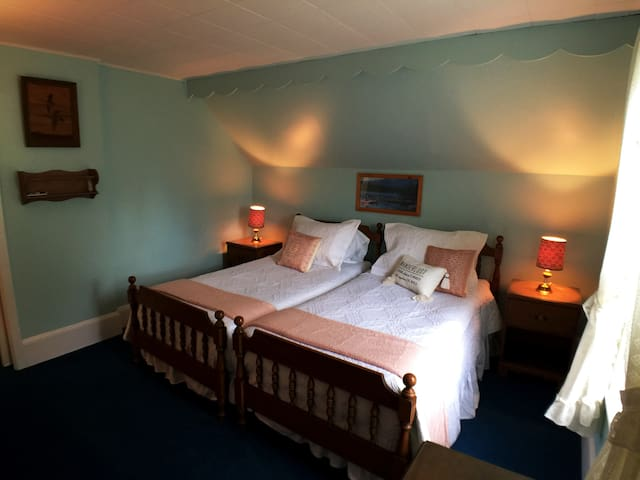 South room - a farm house style bedroom -  you will feel transported back in time to the early 1900's.  Closet has luggage rack and hangers.