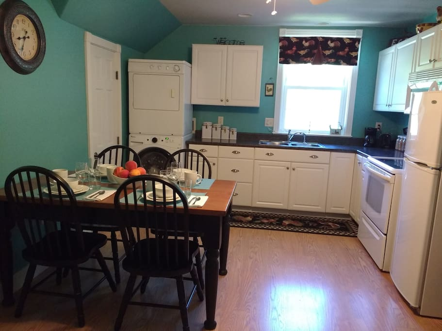 Cheery, fully furnished kitchen.