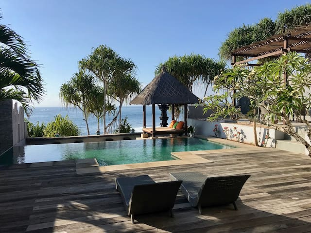 Your spectacular view to enjoy with sunset in the afternoons. While your own private staff discretely pamper you. Direct access to the golden sandy beach and rockpools below.