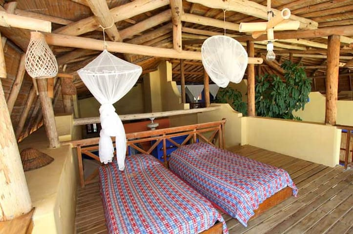 Room 2's loft with single beds.