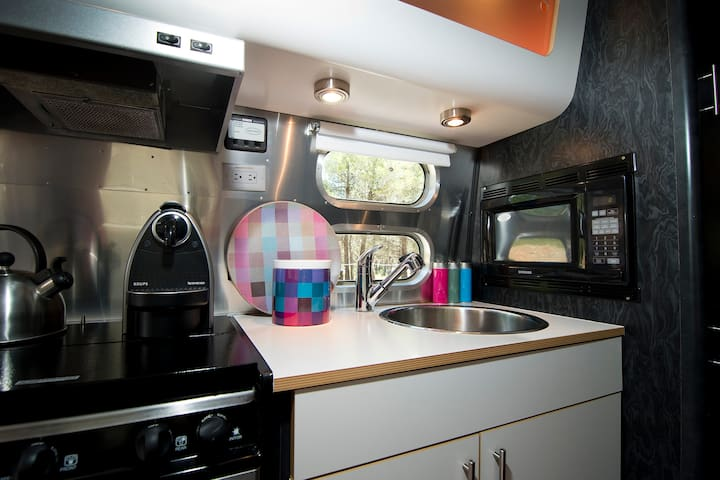 Fully fitted kitchen including microwave, cooker and oven and the all important Nespresso machine.
