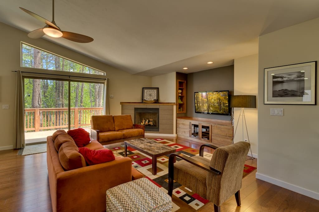Relax in the living room while enjoying the gas fireplace, big screen TV, or the serene tree views out the window.