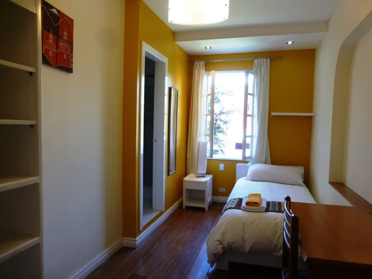 Hotel Cayman. All rooms have private bathrooms and there are several common areas to relax.