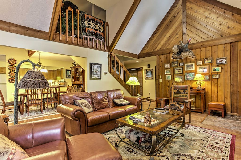 Exposed wood walls and vaulted ceilings highlight the living room.