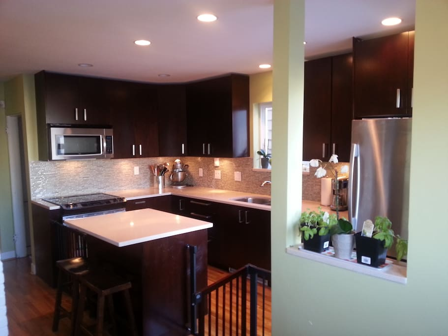 Kitchen with island bar.  (child gates can be removed)
