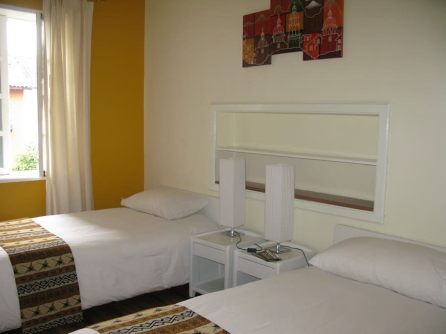 Two single beds or one double bed with orthopedic mattress Private bathroom with hot water Hair dryer.