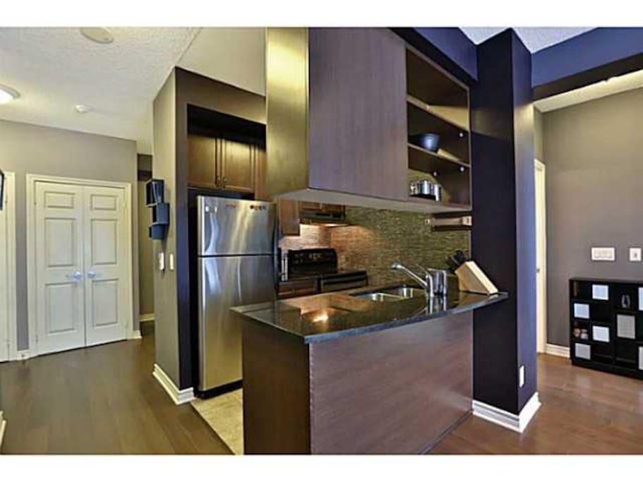 Kitchen with Fridge, Stove and dishwasher
