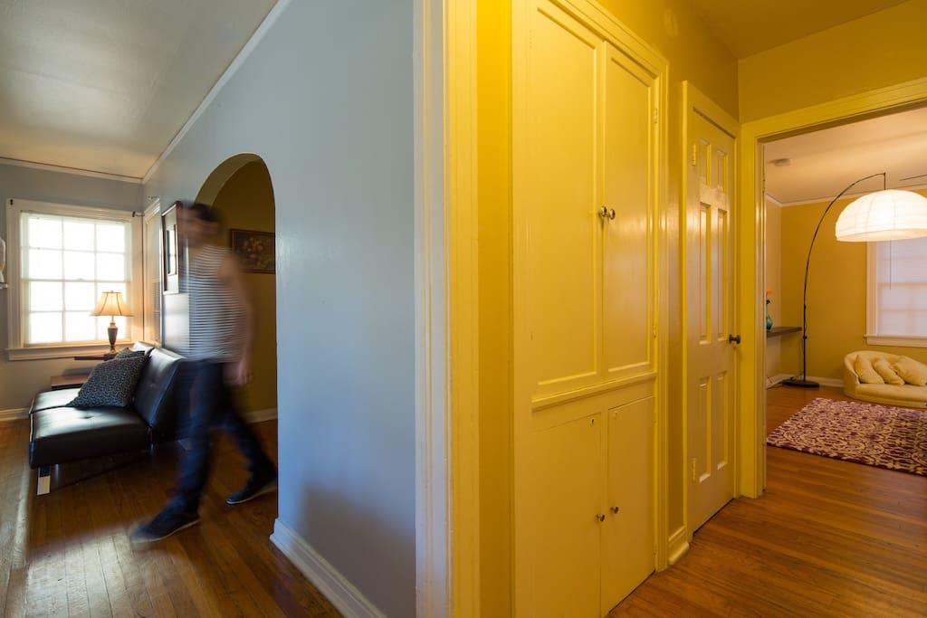 Living room, hallway to bedroom, and original built-ins