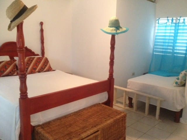 Spacious bedroom suite 16x20 feet with king sized bed  and full bathroom.