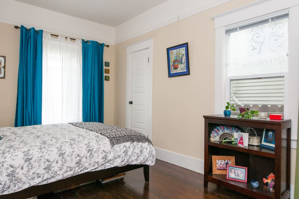 Large master bedroom with queen sized bed and new organic mattress.