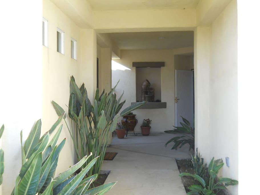 Walkway towards casita entry. Casita is on the left.