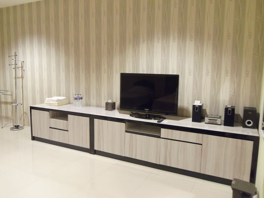 Our Deluxe entertainment console with large TV and Free Wi-Fi