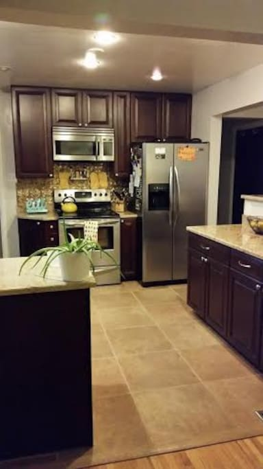 Open kitchen with stainless steel appliances, electric stove, and everything you'll need.